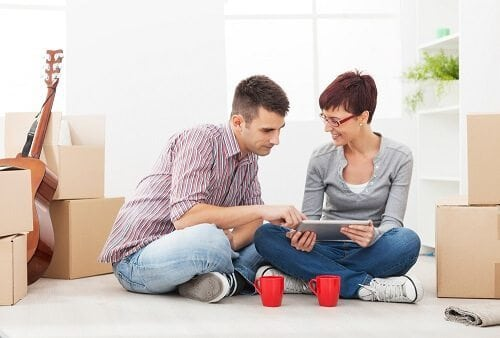 Young couple sitting on the floor making a decision